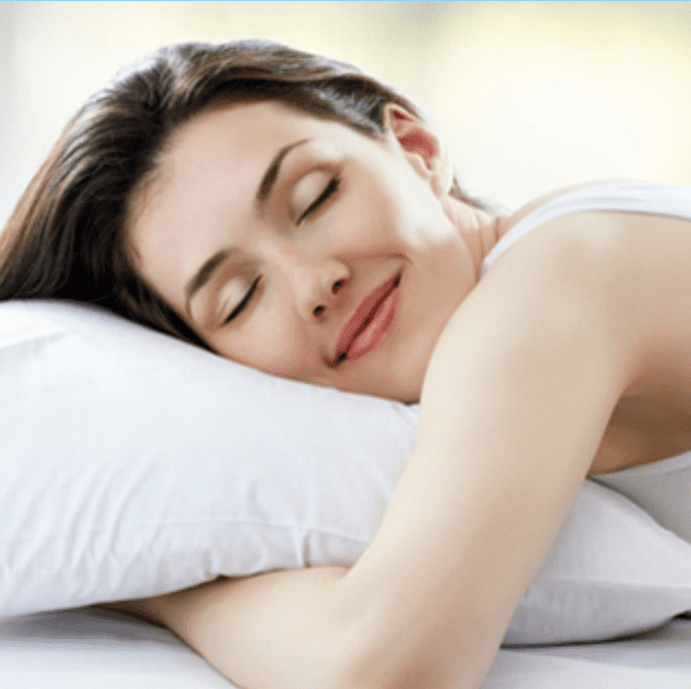 Woman in her 30s sleeping and smiling