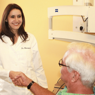 Dr Fay Mansouri an Endodontist in Irvine with a patient
